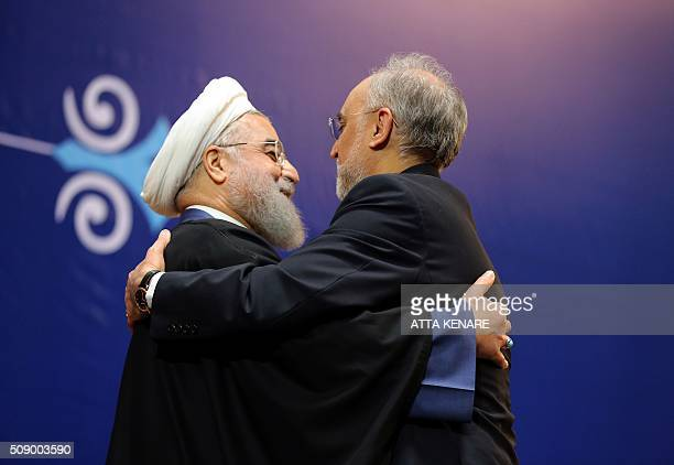 TOPSHOT Iranian President Hassan Rouhani awards Ali Akbar Salehi the head of Iran's Atomic Energy Organisation with the Medal of Honour for his role...