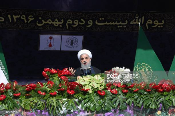 Iranian President Hassan Rouhani delivers a speech during a ceremony to mark the 39th anniversary of the Islamic revolution at Azadi Square in Tehran...