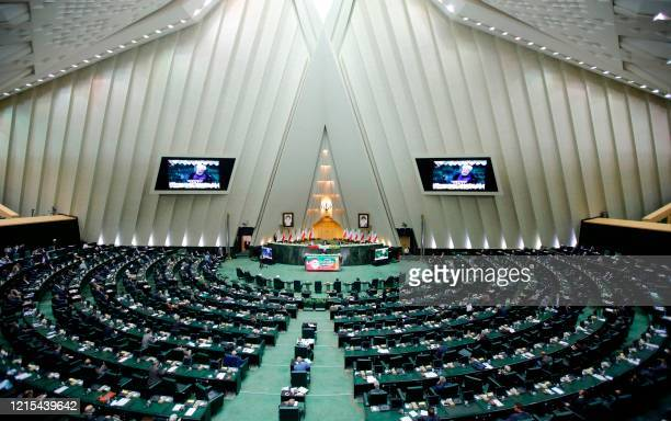 Iranian President Hassan Rouhani delivers a speech during the inaugural session of the new parliament in Tehran on May 27 following February...