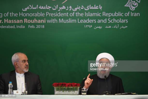 Iranian President Hassan Rouhani delivers a speech to Muslims leaders and scholars as Iran Foreign Affairs Minister Mahamad Javad Zarief listens at a...