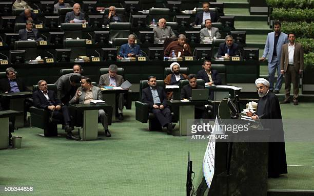 Iranian President Hassan Rouhani delivers a speech to parliament before presenting the proposed annual budget in the capital Tehran on January 17...