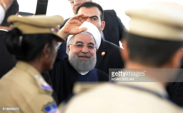 Iranian President Hassan Rouhani gestures towards the media after offering prayers at Mecca Masjid in Hyderabad on February 16 2018 The Iranian...