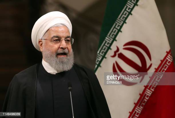 Iranian President Hassan Rouhani gives a joint press conference with the Japanese Prime Minister at the Saadabad Palace in the capital Tehran on June...