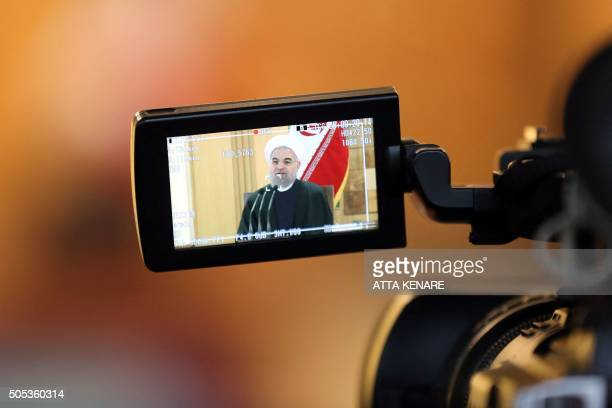 Iranian President Hassan Rouhani is seen on a camera control screen as he speaks during a press conference on January 17 2016 in the capital Tehran...