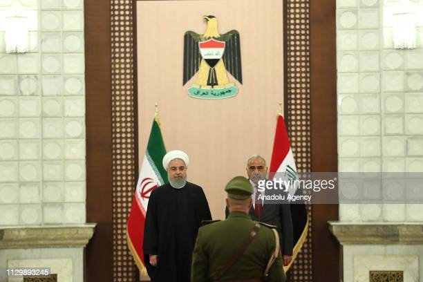 Iranian President Hassan Rouhani is welcomed by Iraqi Prime Minister Adil Abdulmehdi at Iraqi Prime Ministry Palace in Baghdad Iraq on March 11 2019