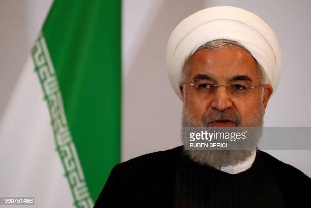 Iranian President Hassan Rouhani looks on as he attends a press conference in Bern on July 3, 2018. - Rouhani is visiting Switzerland and Austria as...
