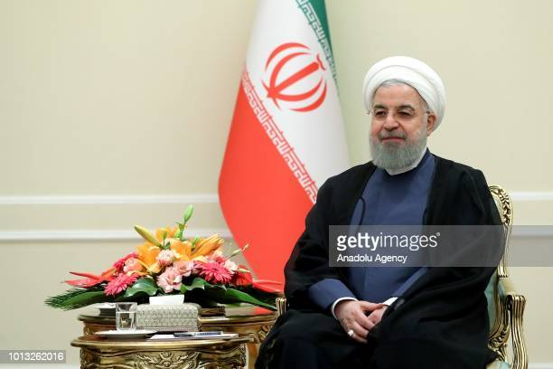 Iranian President Hassan Rouhani meets North Korea's Foreign Minister Ri Yongho at the presidential palace in Tehran Iran on August 8 2018