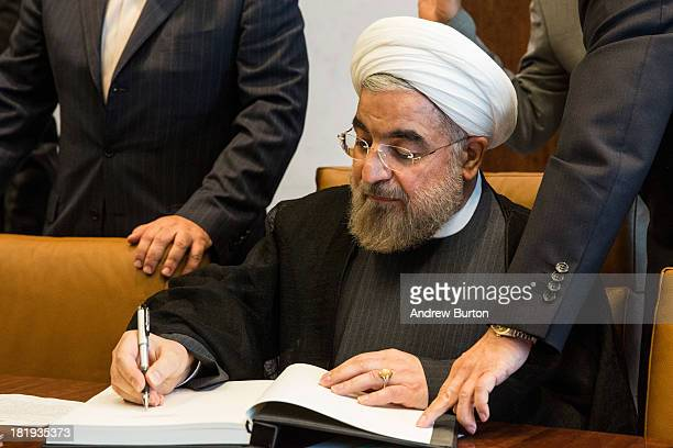 Iranian President Hassan Rouhani signs of the guest book of the United Nations Secretary General on the sidelines of the United Nations General...