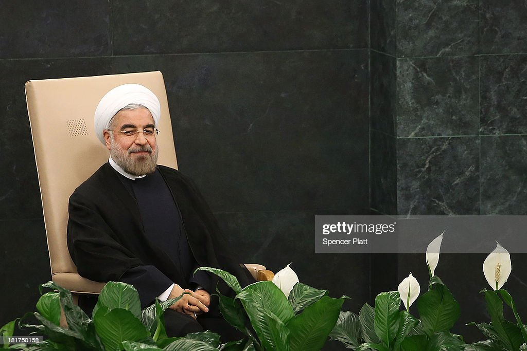 President of Iran Hassan Rouhani sits before speaking at the United Nations (U.N.) General Assembly on September 24, 2013 in New York City. This year's U.N. diplomacy session, the 68th General Assembly, is likely to be dominated by Syria's civil war and Iran's suspected nuclear ambitions. (Photo by Spencer Platt/Getty Images) NEW YORK, NY - SEPTEMBER 24: Iranian President Hassan Rouhani sits before speaking at the United Nations (UN) General Assembly on September 24, 2013 in New York City. Over 120 prime ministers, presidents and monarchs are gathering this week for the annual meeting at the temporary General Assembly Hall at the U.N. headquarters while the General Assembly Building is closed for renovations.