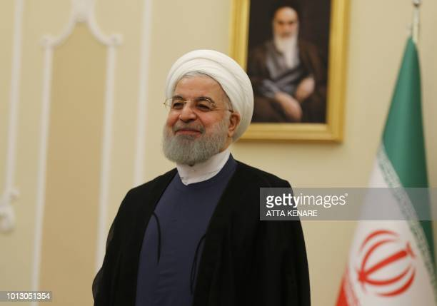 Iranian President Hassan Rouhani smiles during a meeting with the North Korean foreign minister in the capital Tehran on August 8 2018 North Korean...