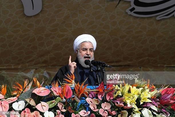 Iranian President Hassan Rouhani speaks during a rally to mark the 37th anniversary of the Islamic revolution in Azadi Square on February 11 2016 in...