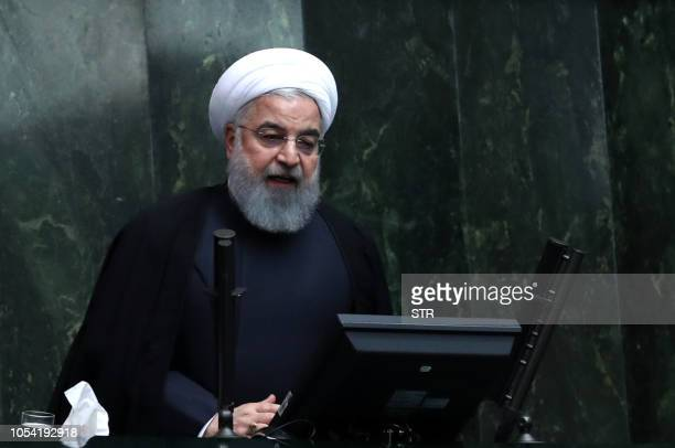 Iranian president Hassan Rouhani speaks to defend his nominations for four ministries during a parliament session in Tehran, on October 27 2018. -...