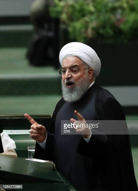 Iranian president Hassan Rouhani speaks to defend his nominations for four ministries during a parliament session in Tehran on October 27 2018 The...