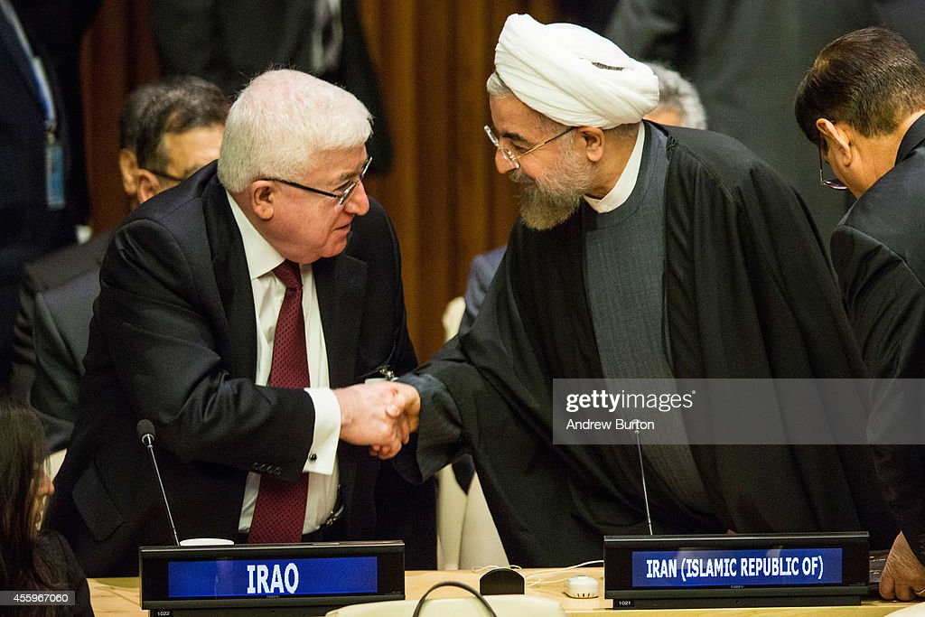 Iranian President Hassan Rouhani (R) speaks with Iraqi President Fuad Masum at the United Nations Climate Summit on September 23, 2014 in New York City. The summit, which is meeting one day before the UN General Assembly begins, is bringing together world leaders, scientists and activists looking to curb climate change.