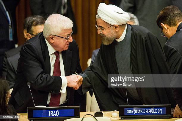 Iranian President Hassan Rouhani speaks with Iraqi President Fuad Masum at the United Nations Climate Summit on September 23 2014 in New York City...