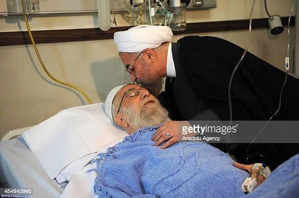 Iranian President Hassan Rouhani visits Iran's supreme leader, Ayatollah Ali Khamenei, after his prostate surgery at a hospital in Tehran, Iran on...