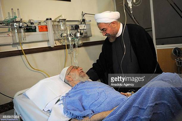 Iranian President Hassan Rouhani visits Iran's supreme leader Ayatollah Ali Khamenei after his prostate surgery at a hospital in Tehran Iran on...