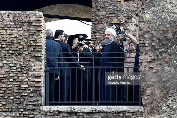 Iranian President Hassan Rouhani waves to photographers during his visit at the Rome's Coliseum on January 27, 2016 prior to leave to Paris.