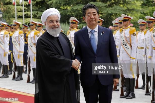 Iranian President Hassan Rouhani welcomes Japanese Prime Minister Shinzo Abe during a welcoming ceremony at the Saadabad Palace in the capital Tehran...