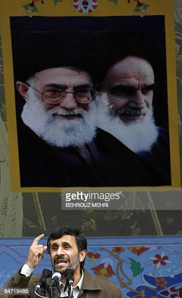 Iranian President Mahmoud Ahmadinejad adresses the crowd under portraits of Iran's supreme leader, Ayatollah Ali Khamenei and Iran's late founder of...