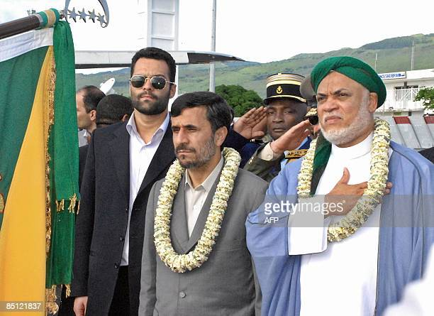 Iranian President Mahmoud Ahmadinejad and his Comoran counterpart Ahmed Abdallah Sambi listen to national anthems on February 25 2009 upon his arival...