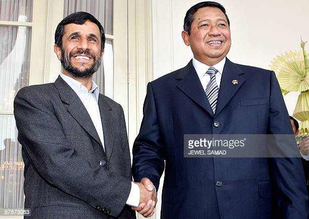 Iranian President Mahmoud Ahmadinejad and his Indonesian counterpart Susilo Bambang Yudhoyono are all smile as they pose for photographs before...
