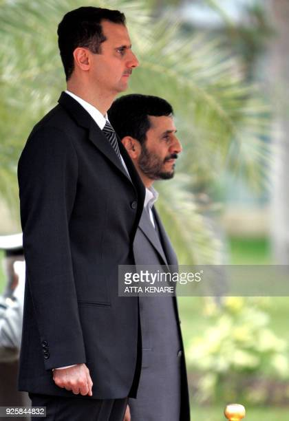 Iranian President Mahmoud Ahmadinejad and his Syrian counterpart, Bashar al-Assad review an honour guard during a welcoming ceremony in Tehran 17...