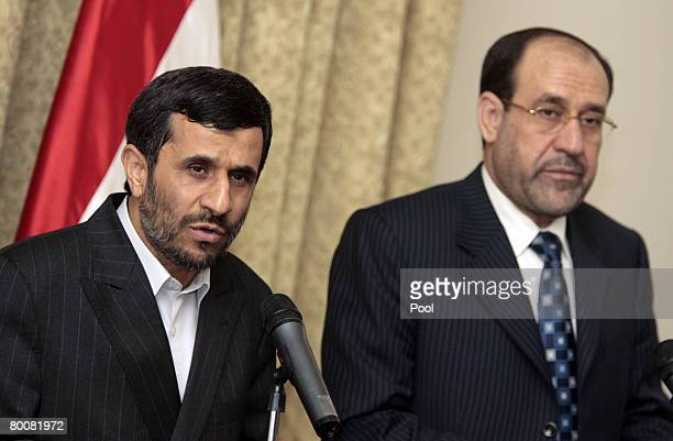 Iranian President Mahmoud Ahmadinejad and Iraqi Prime Minister Nuri alMaliki hold a joint press conference in the heavily fortified Green Zone March...