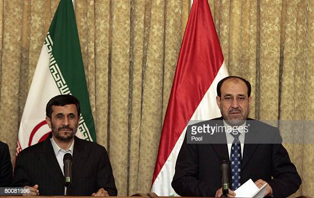Iranian President Mahmoud Ahmadinejad and Iraqi Prime Minister Nuri alMaliki hold a joint press conference at the latter's office in the heavily...