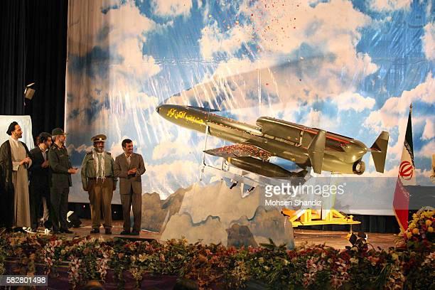 Iranian President Mahmoud Ahmadinejad attends the unveiling ceremony of a longrange drone the Karrar