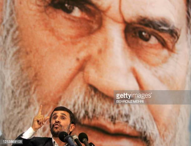 Iranian President Mahmoud Ahmadinejad delivers his speech in front of a portrait of Iran's late founder of the Islamic Republic Ayatollah Ruhollah...