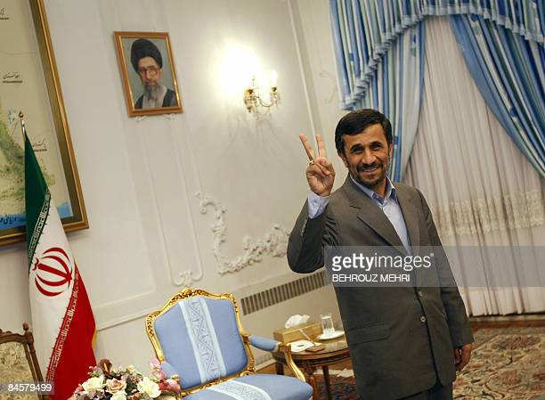 Iranian President Mahmoud Ahmadinejad flashes the V for victory sign as he waits to receive the political supremo of Palestinian Islamist movement...
