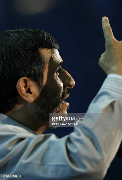 Iranian President Mahmoud Ahmadinejad gestures as he delivers his speech for the 19th anniversary of the death of Iran's late founder of the Islamic...