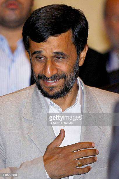 Iranian President Mahmoud Ahmadinejad gestures as he enters the Meeting of Friends of the Chair of the 10th Islamic Summit Conference in Putrajaya,...