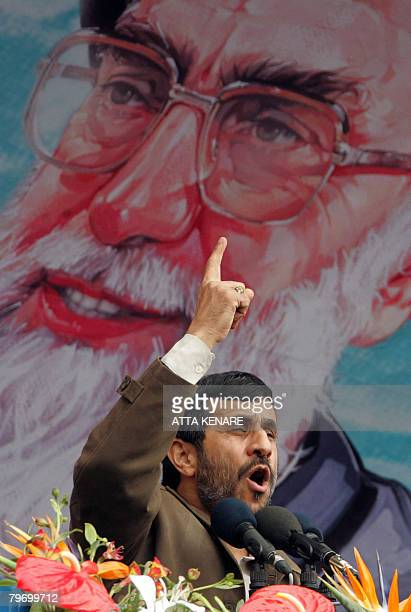 Iranian President Mahmoud Ahmadinejad gestures under a portrait of Iran's supreme leader Ayatollah Ali Khamenei as he delivers a speech during a...