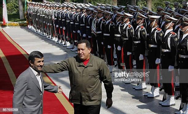 Iranian President Mahmoud Ahmadinejad greets his Venezuelan counterpart Hugo Chavez during a welcoming ceremony in Tehran on April 2 2009 Chavez flew...