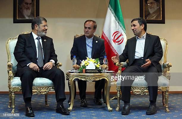 Iranian President Mahmoud Ahmadinejad meets with his Egyptian counterpart Mohamed Morsi on the sidelines of the Non-Aligned Movement summit in Tehran...