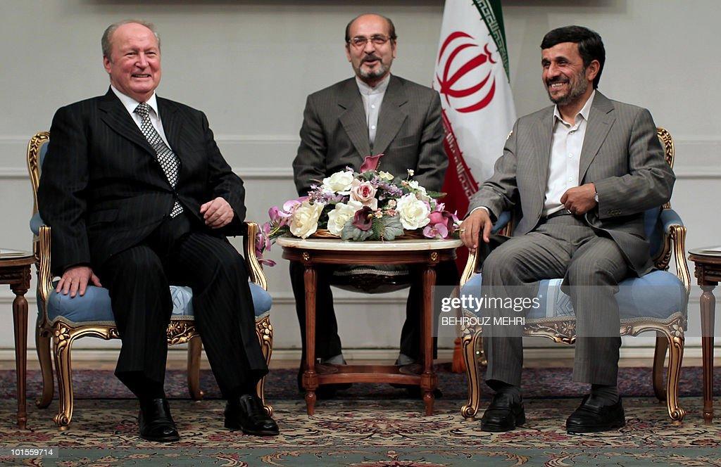 Iranian President Mahmoud Ahmadinejad (R) meets with Syrian parliament speaker Mahmud al-Abrash (L) in Tehran on June 2, 2010.