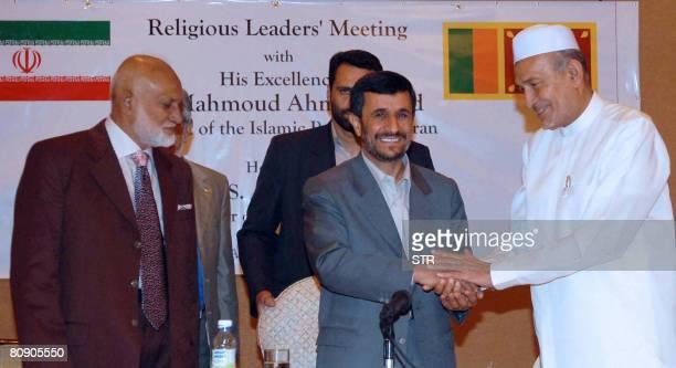 Iranian President Mahmoud Ahmadinejad shakes hands with a Sri Lankan Muslim politician Alavi Moulana as Sri Lankan Energy Minister A H M Fowzie looks...