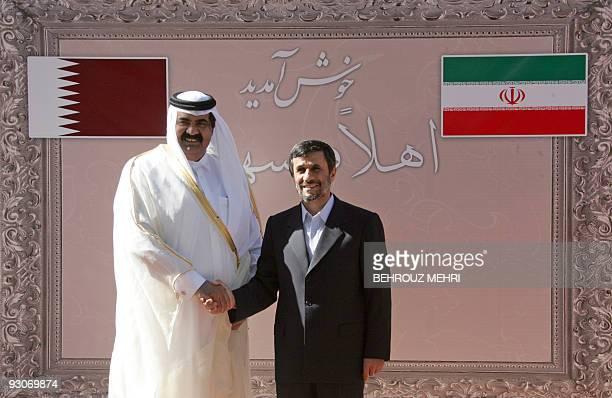 Iranian President Mahmoud Ahmadinejad shakes hands with the Emir of Qatar Sheikh Hamad bin Khalifa alThani in Tehran on November 5 2009 The Qatari...