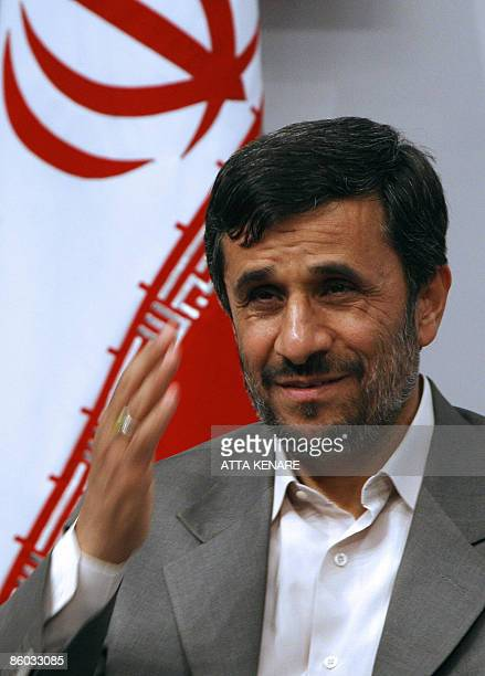 Iranian President Mahmoud Ahmadinejad smiles during a welcoming ceremony for former Turkish prime minister and chief of the Islamic Refah party...