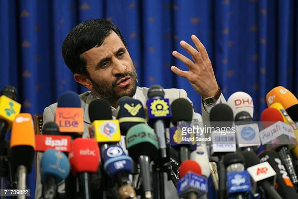 Iranian President Mahmoud Ahmadinejad talks during a news conference August 29 2006 in Tehran Iran Ahmadinejad challenged US President Bush to a live...