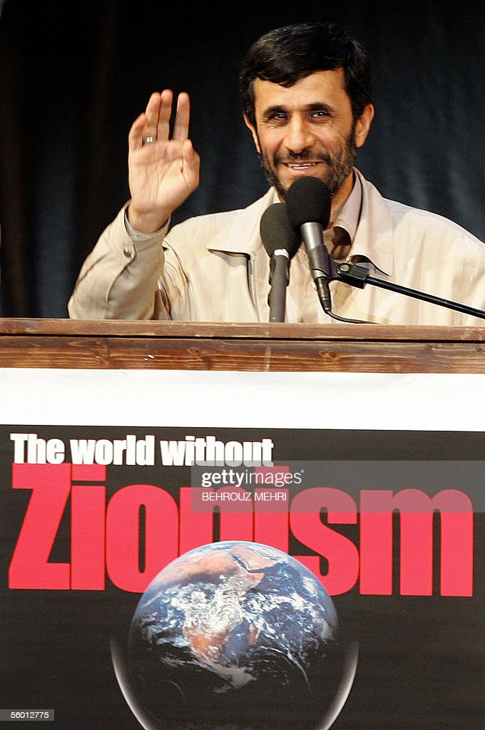 iranian president mahmoud ahmadinejad waves during a conference in tehran entitled the world without zionism