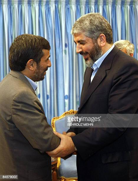 Iranian President Mahmoud Ahmadinejad welcomes the political supremo of Palestinian Islamist movement Hamas Khaled Meshaal upon his arrival for a...