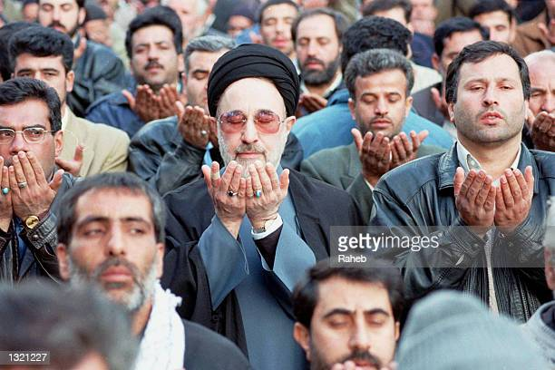 Iranian President Mohammad Khatami center prays among the people during Friday prayers December 22 2000 after a Jerusalem Day demonstration in Tehran...