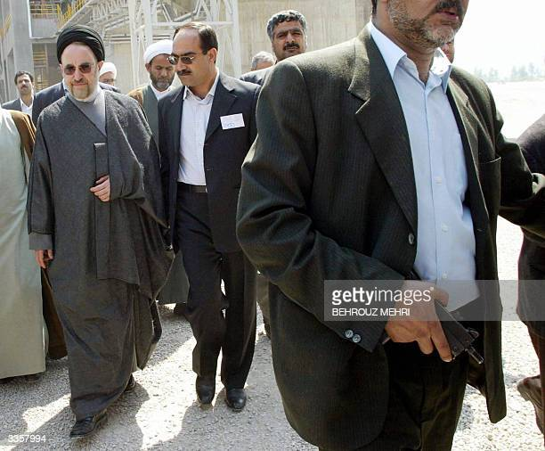 Iranian President Mohammad Khatami escorted by his bodyguards tours a cement factory after its inauguration in Dashtestan 75 kms east of the city of...