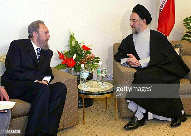 Iranian President Seyed Mohammad Khatami holds bilateral talks with Cuban President Fidel Castro at the 13th NonAligned Movement Summit in Kuala...