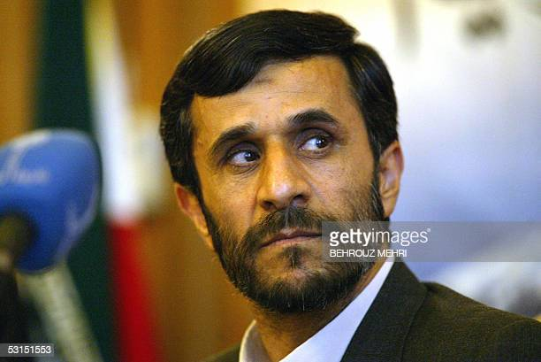 Iranian Presidentelect Mahmood Ahmadinejad listens to reporters during a press conference in Tehran 26 June 2005 Ahmadinejad pledged to form a...