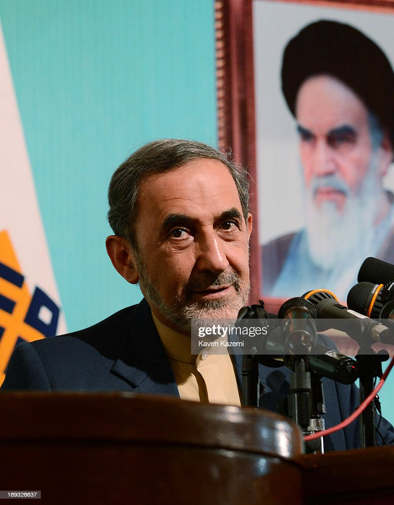 Iranian presidential candidate Dr. Ali Akbar Velayati, the former foreign minister of Iran and a special adviser to the supreme Iranian leader Ayatollah Ali Khamenei, speaks under a picture of Khamenei about his presidential agenda at Tehran University on May 23, 2013 in Tehran, Iran. Velayati is one eight candidates approved to run in the June 14, presidential election to succeed President Mahmoud Ahmadinejad.