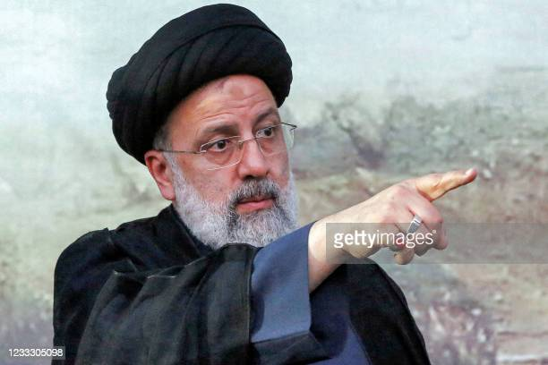 Iranian presidential candidate Ebrahim Raisi gestures during an election campaign rally in the city of Eslamshahr, about 25 kilometres south of the...